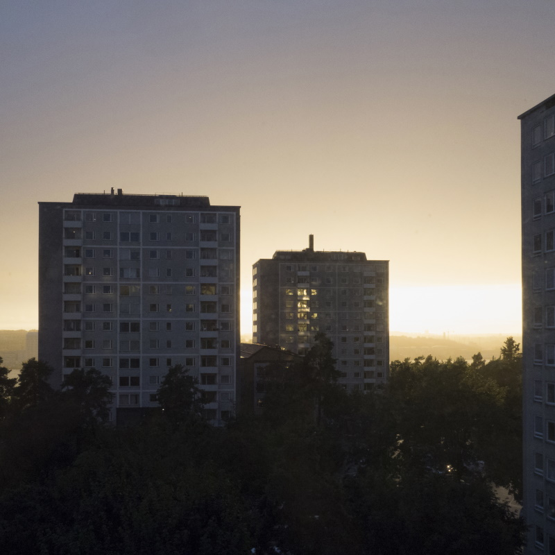 apartment buildings at sunset H4ATDX8