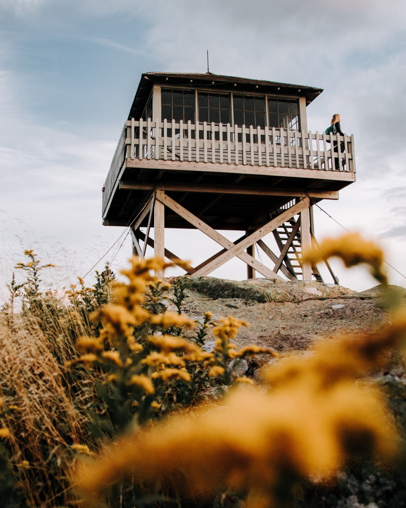 looking out of a firetower atop a mountain in new  ZBNXFPM